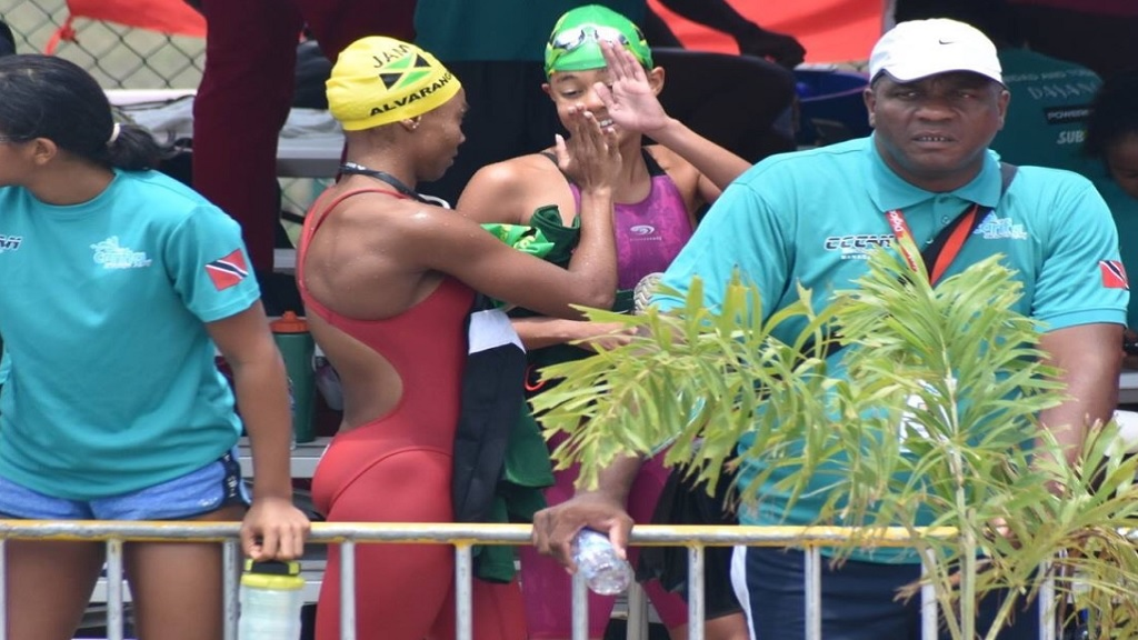 Zaneta Alvaranga (left) and Sabrina Lyn share a high-five after competing against each at the 2019 Carifta Swimming Championships in Barbados.