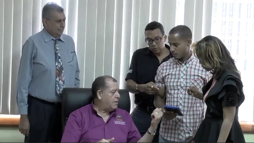 The Jamaica Coffee Corporation team showed Agriculture Minister Audley Shaw a brief demo of the app.