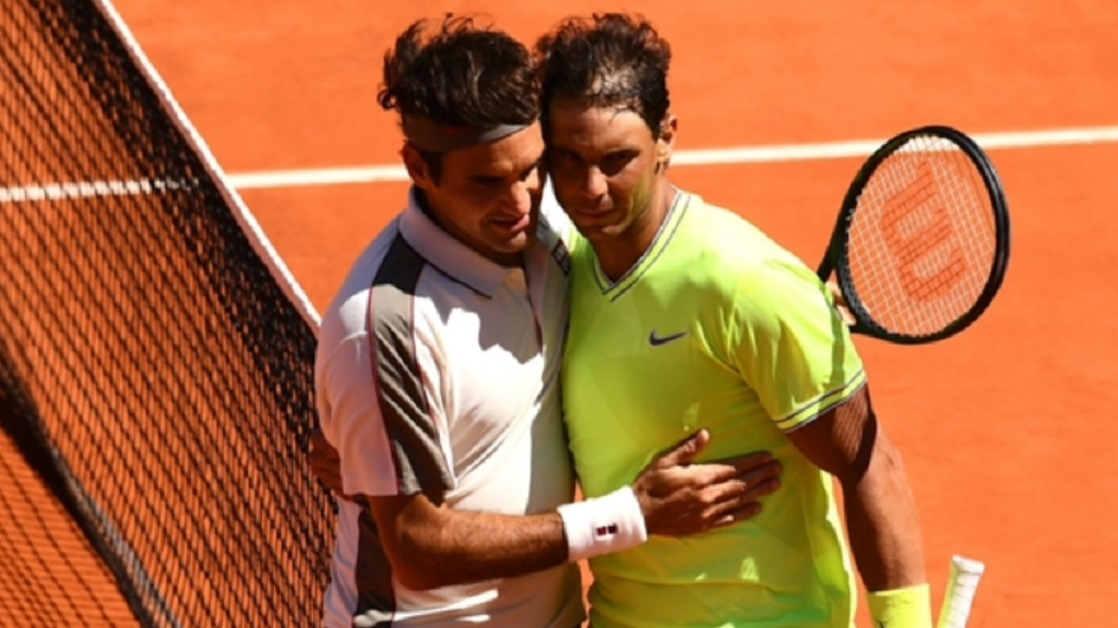 Rafael Nadal and Roger Federer embrace after their French Open semi-final.
