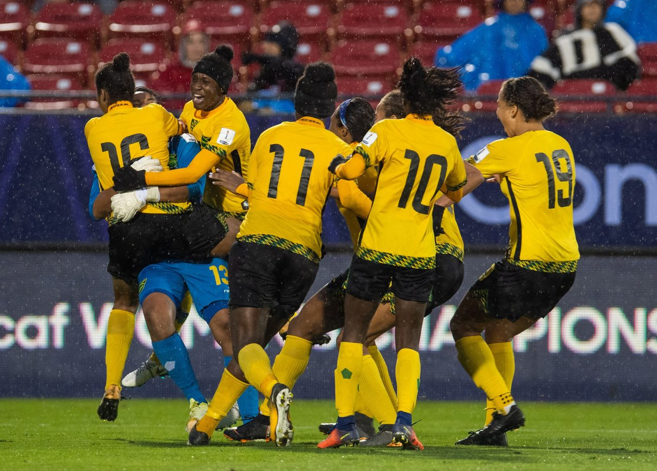 Jamaican players celebrate last year after qualifying for the Women's World Cup.