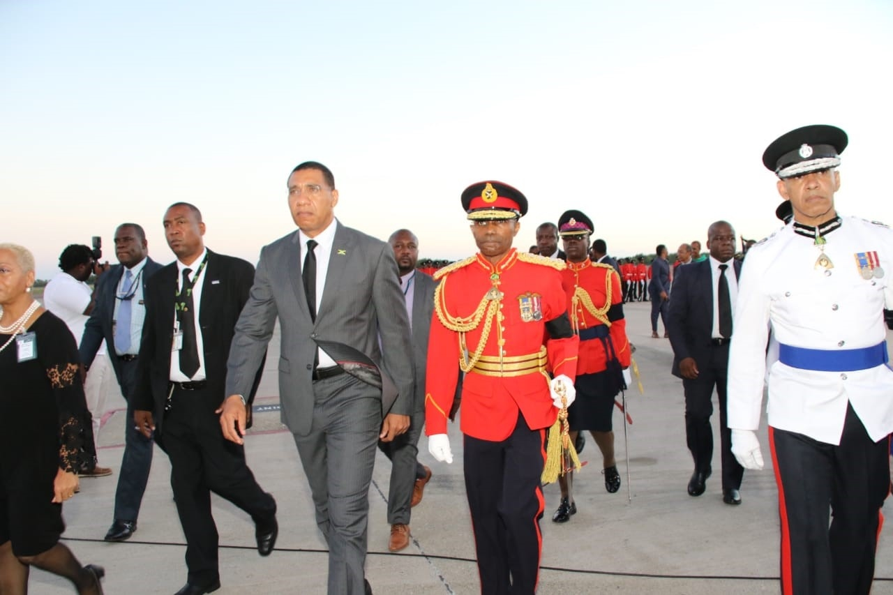 Prime Minister Andrew Holness, flanked by officials including the army and police chiefs, on his arrival at the Norman Manley International Airport in Kingston Sunday afternoon for the official reception of the body of former Prime Minister, Edward Seaga. (Photos: Llewellyn Wynter)