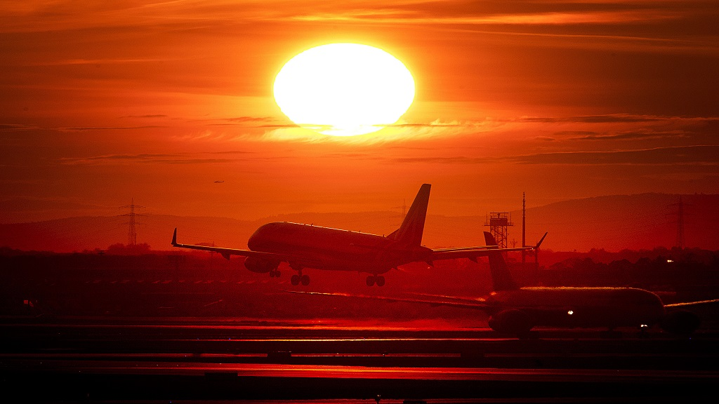 In this Wednesday, March 20, 2019 file photo an aircraft lands at the international airport in Frankfurt, Germany, as the sun sets. There is a small but growing movement in Sweden that's consciously shunning air travel because of its impact on the environment. (AP Photo)