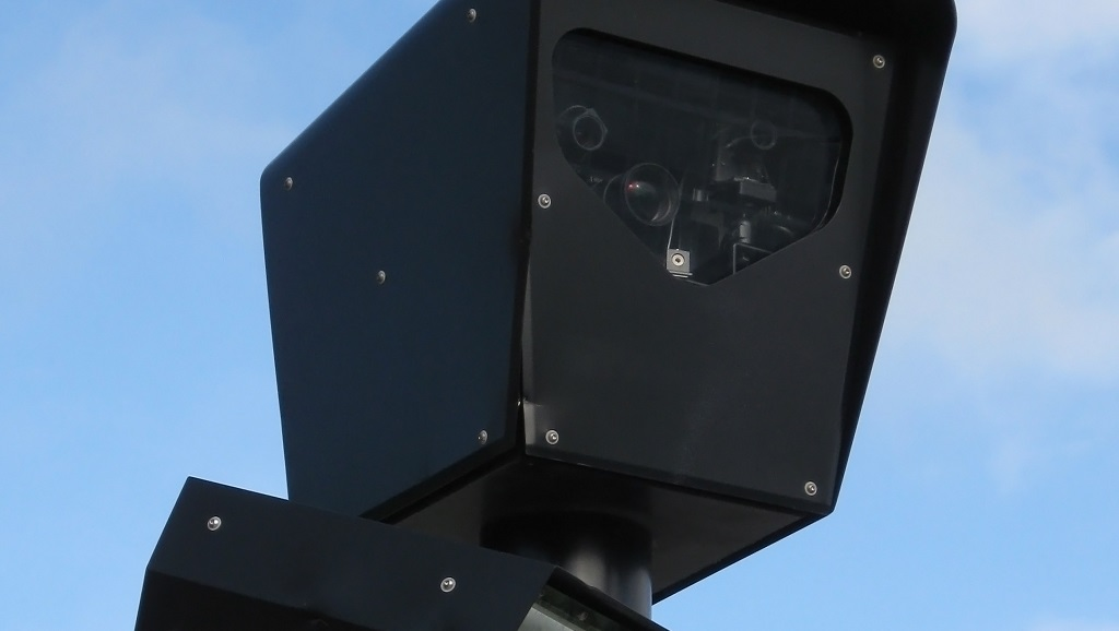 A Red Light Camera Enforcement System in Chicago, Illinois, USA.  Photo by Joe Ravi, CC BY-SA 3.0. Photo via Wikipedia.
