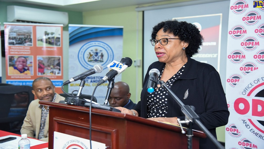Chairman of the Office of Disaster Preparedness and Emergency Management (ODPEM), Joy Douglas, addresses a press conference last Friday at ODPEM'S offices in New Kingston, to launch activities for Disaster Preparedness Month. Also pictured (from left) are Director of the Meteorological Service, Evan Thompson and Manager, Communication and Customer Services, National Works Agency (NWA), Stephen Shaw.