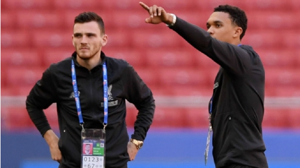 Liverpool full-backs Andy Robertson (left) and Trent Alexander-Arnold survey the scene at the Wanda Metropolitano.