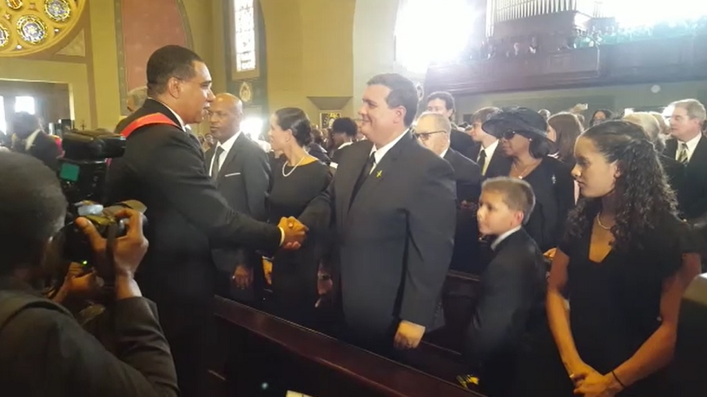 Prime Minister Andrew Holness greets Andrew Seaga, the son of the late former Prime Minister Edward Seaga, at the state funeral for the late Seaga at the Holy Trinity Cathedral in Kingston on Sunday.