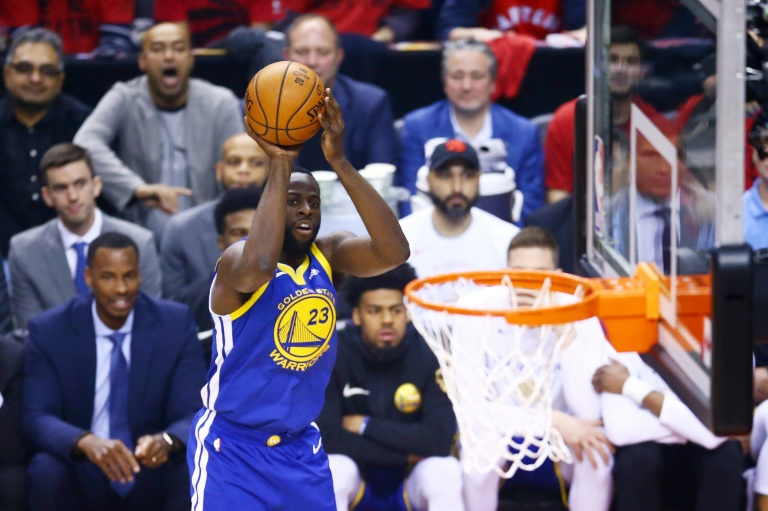 L'intérieur des Warriors Draymond Green tente un panier contre les Raptors lors du match 2 des finales NBA à Toronto, le 2 juin 2019