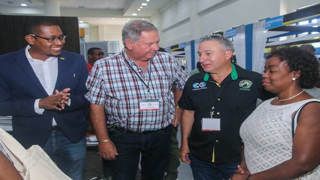 From left, Minister of State in the Ministry of Industry, Commerce and Agriculture, Floyd Green; Brian Pengelley, Chairman, Jamaica International Exhibition (JIE), Metry Seaga, President, Jamaica Manufacturers' and Exporters' Association (JMEA); and Gloria Henry, president of the Business Process Industry Association of Jamaica, at the  2019 JIE at the Montego Bay Convention Centre on Saturday.