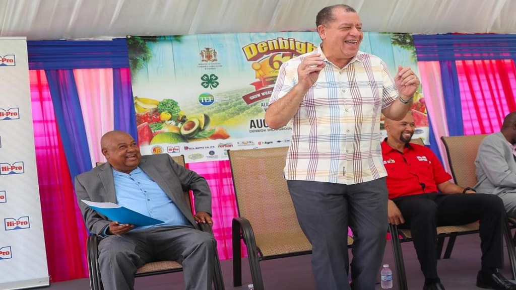 Industry, Commerce, Agriculture and Fisheries Minister, Audley Shaw (foreground), in a light-hearted mood during his address at Wednesday's launch of Denbigh Agricultural, Industrial and Food Show at Hi-Pro Supercentre at White Marl in St Catherine. Also pictured enjoying the moment are Lenworth Fulton, President of the Jamaica Agricultural Society (JAS) and Colonel Jaimie Ogilvie, Assistant Vice President, Hi-Pro Division, Jamaica Broilers Group.