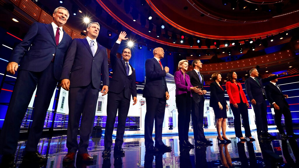From left, NYC Mayor Bill de Blasio, Rep. Tim Ryan, D-Ohio, former Housing and Urban Development Secretary Julian Castro, Sen. Cory Booker, D-N.J., Sen. Elizabeth Warren, D-Mass., former Texas Rep. Beto O'Rourke, Sen. Amy Klobuchar, D-Minn., Rep. Tulsi Gabbard, D-Hawaii, Washington Gov. Jay Inslee, and former Maryland Rep. John Delaney pose for a photo on stage before the start of a Democratic primary debate at the Adrienne Arsht Center for the Performing Arts. (AP Photo/Brynn Anderson)