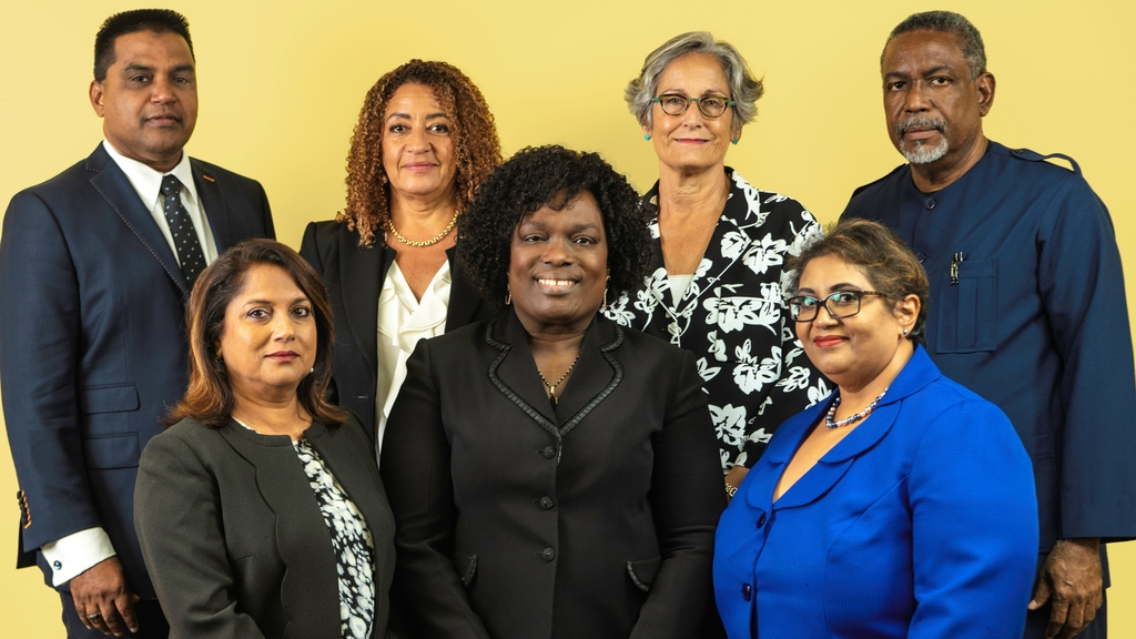 (front row, from left) HH Mrs. Indra Rampersad-Suite, HH Mrs. Deborah Thomas-Felix, President of the Industrial Court of Trinidad and Tobago, HH Ms. Wendy Ali. (back row, from left) HH Mr. Nizam Khan, HH Ms. Elizabeth Solomon, HH Mrs. Angela Hamel-Smith and HH Mr. Vincent Cabrera