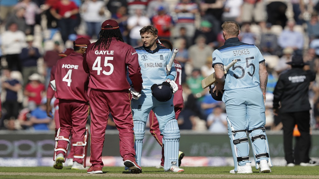 England's Joe Root, centre right, shakes hands with West Indies' Chris Gayle, 45, at the end of the Cricket World Cup match at the Hampshire Bowl in Southampton, England, Friday, June 14, 2019. England won by eight wickets.
