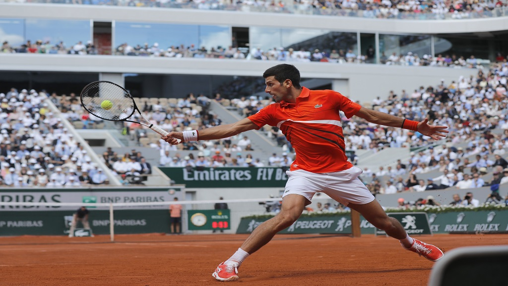 Serbia's Novak Djokovic plays a shot against Germany's Alexander Zverev during their quarterfinal match of the French Open tennis tournament at the Roland Garros stadium in Paris, Thursday, June 6, 2019.