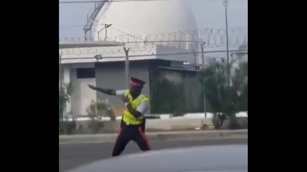 A screen grab from a video of a traffic cop demonstrating flair and enthusiasm on traffic control duties locally.