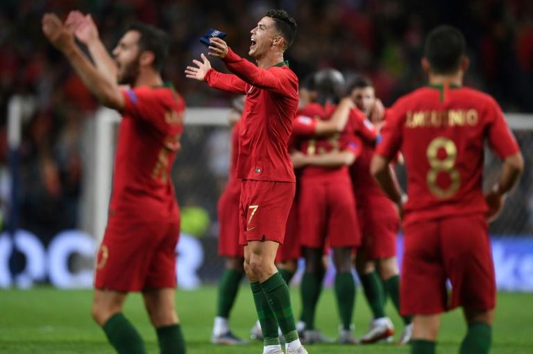 Les Portugais vainqueurs de la première Ligue des nations contre les Pays-Bas à Porto, le 9 juin 2019 AFP / PATRICIA DE MELO MOREIRA