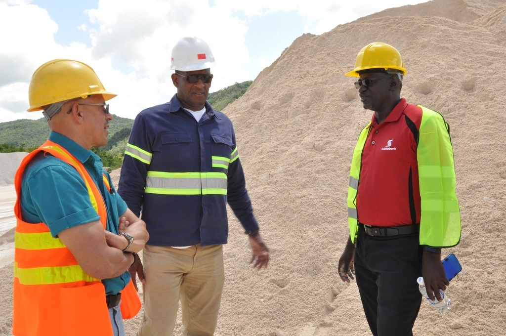 Eddie Cousins, Director of Lydford Mining and his Operations Director, Sam Millington, talk with Daniel Brown, Senior Manager of the mid-market segment of Scotiabank's Corporate and Commercial Banking at the site of their mining operations in St Ann.