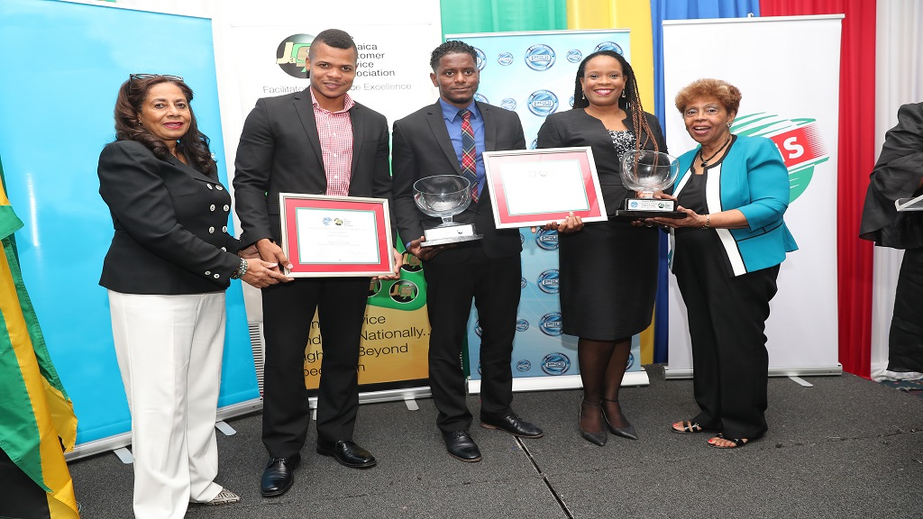 Barrington Groves, Client Experience Manager, Sagicor Life (2nd left); Andre Latchman, Manager, Group Client Experience, Sagicor Group Jamaica (centre); and Ava Dixon, Assistant Vice President, Group Client Experience, Sagicor Group Jamaica (2nd right); accept awards for Best Customer Service in the large company category from Marie Matthews, Board Director, Jamaica Customer Service Association (1st left); and Ilsa duVerney, JACSA (1st right) at the PSOJ/JACSA Service Excellence Award held recently.