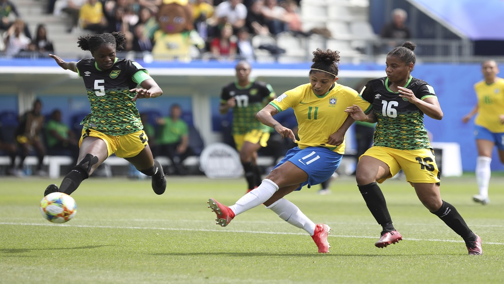 Brazil's Cristiane, centre, is flanked by Jamaica's Konya Plummer, left, and Jamaica's Dominique Bond-Flasza during the Women's World Cup Group C match between Brazil and Jamaica in Grenoble, France, Sunday, June 9, 2019. (AP Photo/Laurent Cipriani)