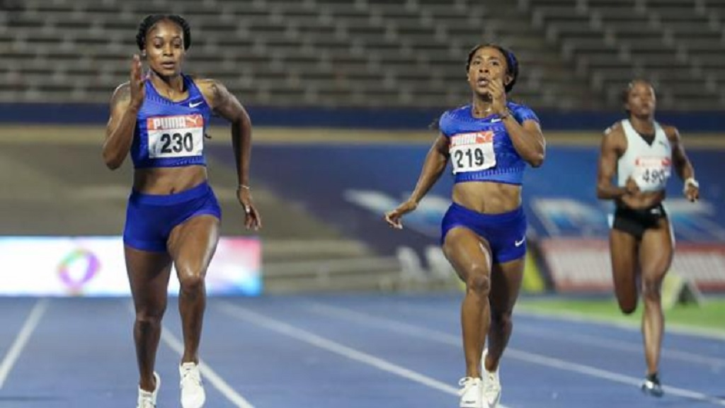 Elaine Thompson (left) moves away from Shelly-Ann Fraser-Pryce to win the 200m at the Jamaican trial on Sunday, June 23, 2019.