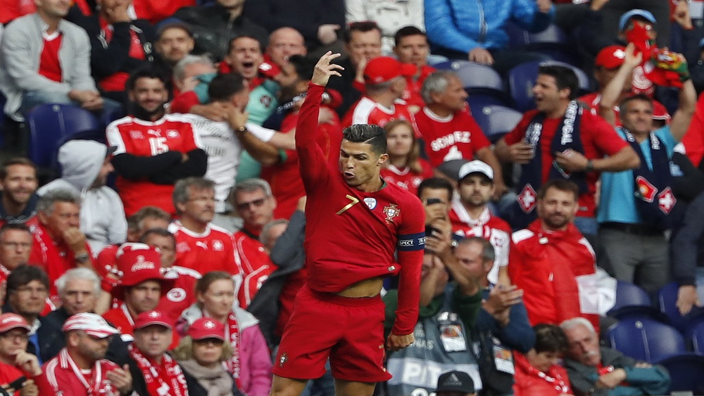 Portugal's Cristiano Ronaldo celebrates after scoring the first of his three goals during the UEFA Nations League semifinal football match against Switzerland at the Dragao stadium in Porto, Portugal, Wednesday, June 5, 2019.