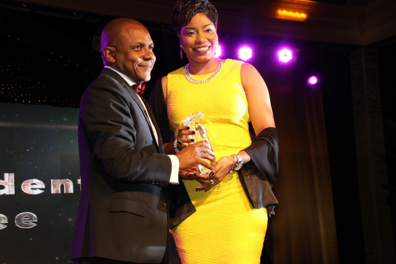 Denneisha Blair receives the President's Award from Courtney Campbell, President and CEO of the Victoria Mutual Group. (PHOTOS: Llewellyn Wynter)