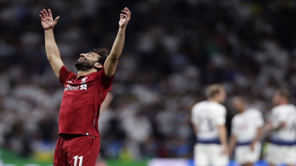 Liverpool's Mohamed Salah celebrates their victory after beating Tottenham 2-0 in the Champions League final at the Wanda Metropolitano Stadium in Madrid, Saturday, June 1, 2019.