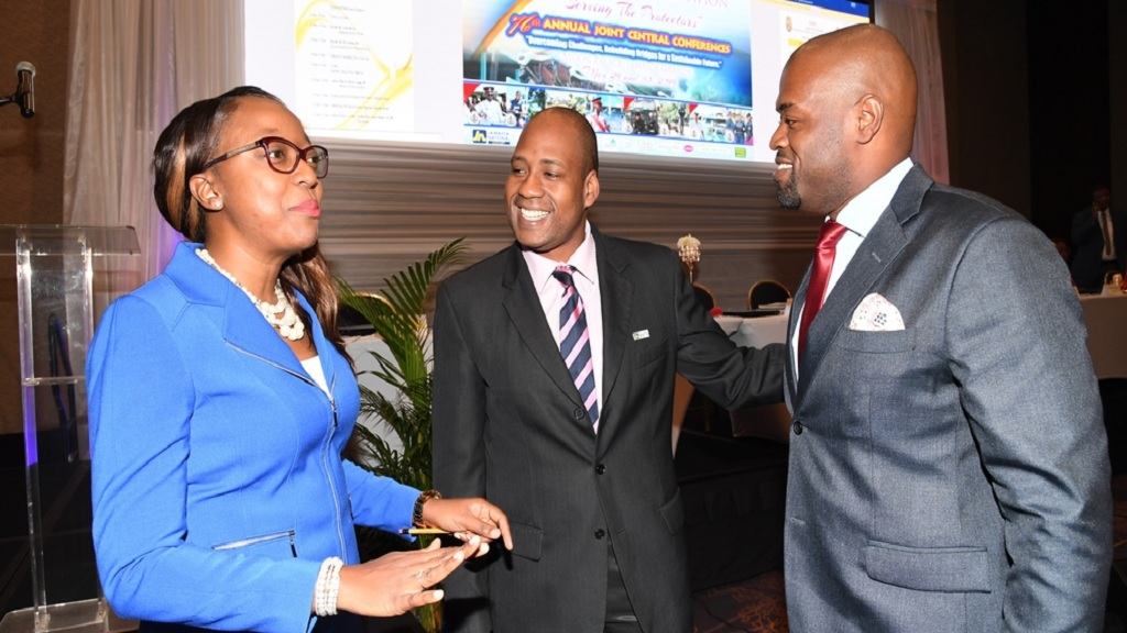 Ryan Parkes (centre), chief of business banking and public sector engagement at JN Bank, in conversation with outgoing chairman of the Jamaica Police Federation, Corporal Arleen McBean (left) and new chairman, Sergeant Patrae Rowe.