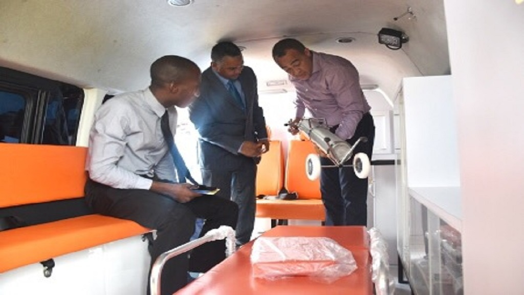 Health Minister Dr Christopher Tufton (right) checks out one of the new ambulances along with the Vice Chairman of the SRHA Board, Michael Stern (centre) and Dimitri South, who represented Member of Parliament for North East Manchester, Audley Shaw at the handing over ceremony.