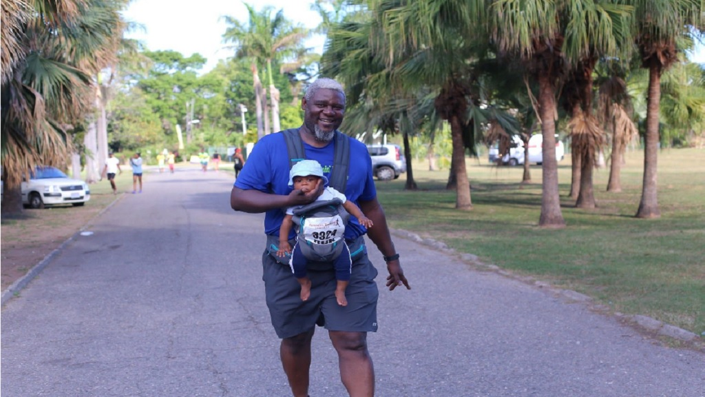 This excited dad was joined by his baby on the route through Hope Pastures and Barbican.(Photo contributed)