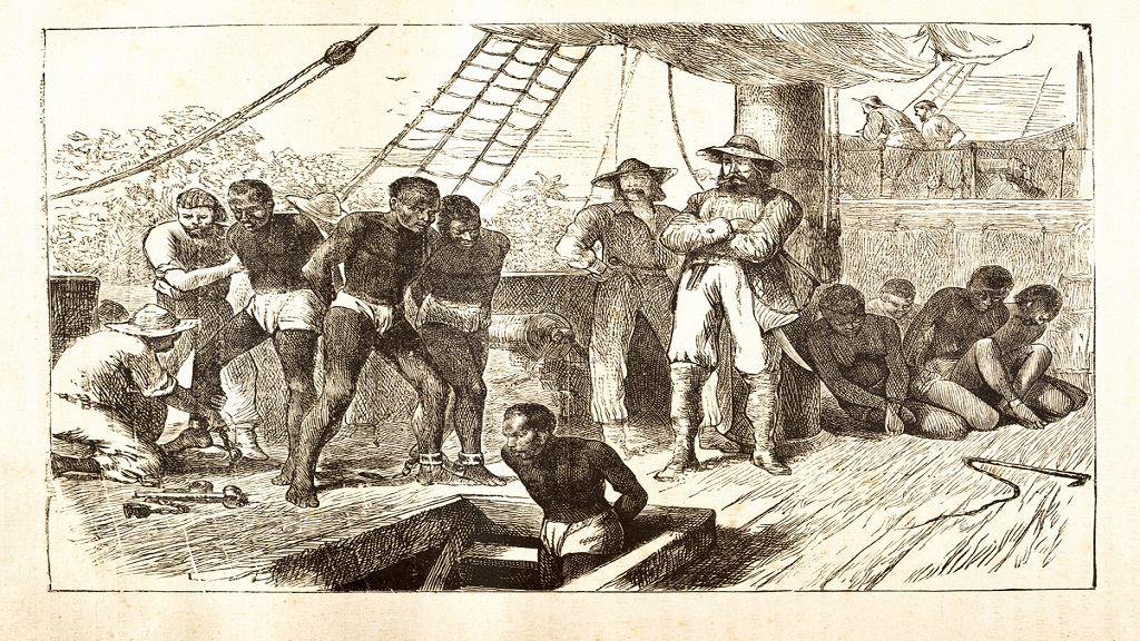 An illustration of African slaves being loaded onto a ship.