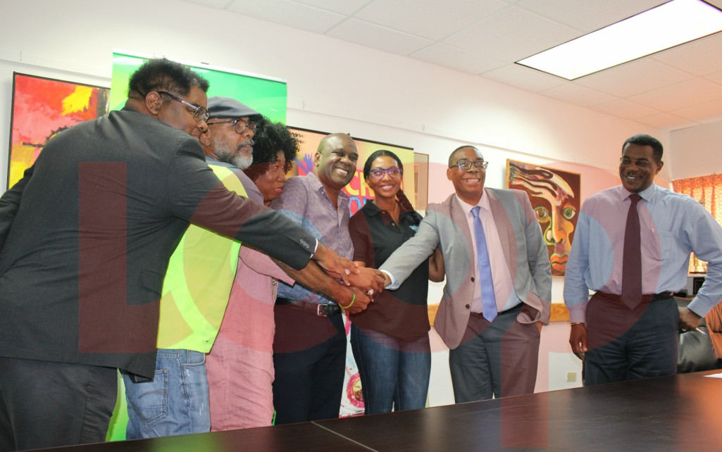 (L-R) Andre Hoyte, Business Development Officer NCF, Freddie Hill of FAS7Star, NCF CEO Carol Roberts-Reifer, Rudy Maloney of 4D Entertainment, Tracy Highland of Tipsy Entertainment, Minister John King and Wayne Webster, Manager Administration of NCF.