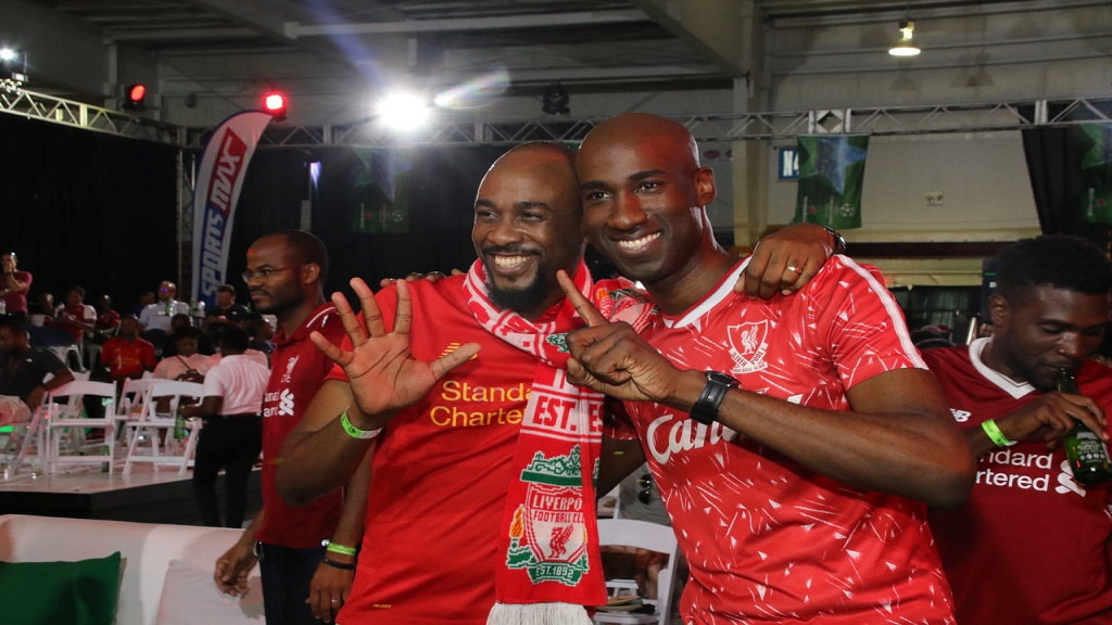 KFC brand manager Andrei Roper (right) and a fellow Liverpool fan basking in their team's Champion's League success. (PHOTOS: Llewellyn Wynter)