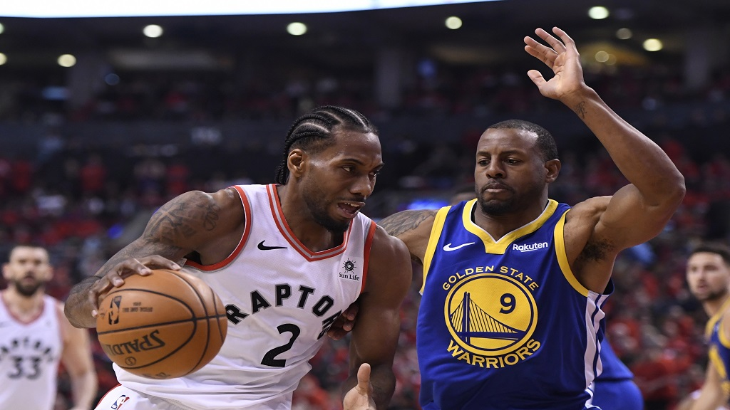 Toronto Raptors forward Kawhi Leonard (2) drives against Golden State Warriors forward Andre Iguodala (9) during second-half basketball action in Game 5 of the NBA Finals in Toronto, Monday, June 10, 2019.