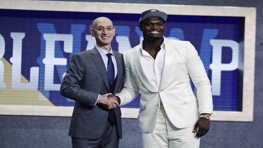 Duke's Zion Williamson, right, poses for photographs with NBA Commissioner Adam Silver after being selected by the New Orleans Pelicans as the first pick during the NBA basketball draft Thursday, June 20, 2019, in New York.