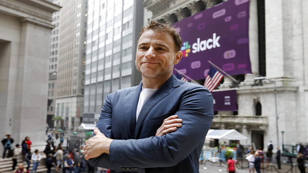 Slack CEO Stewart Butterfield poses for photos outside the New York Stock Exchange before his company's IPO, Thursday. (AP Photo)