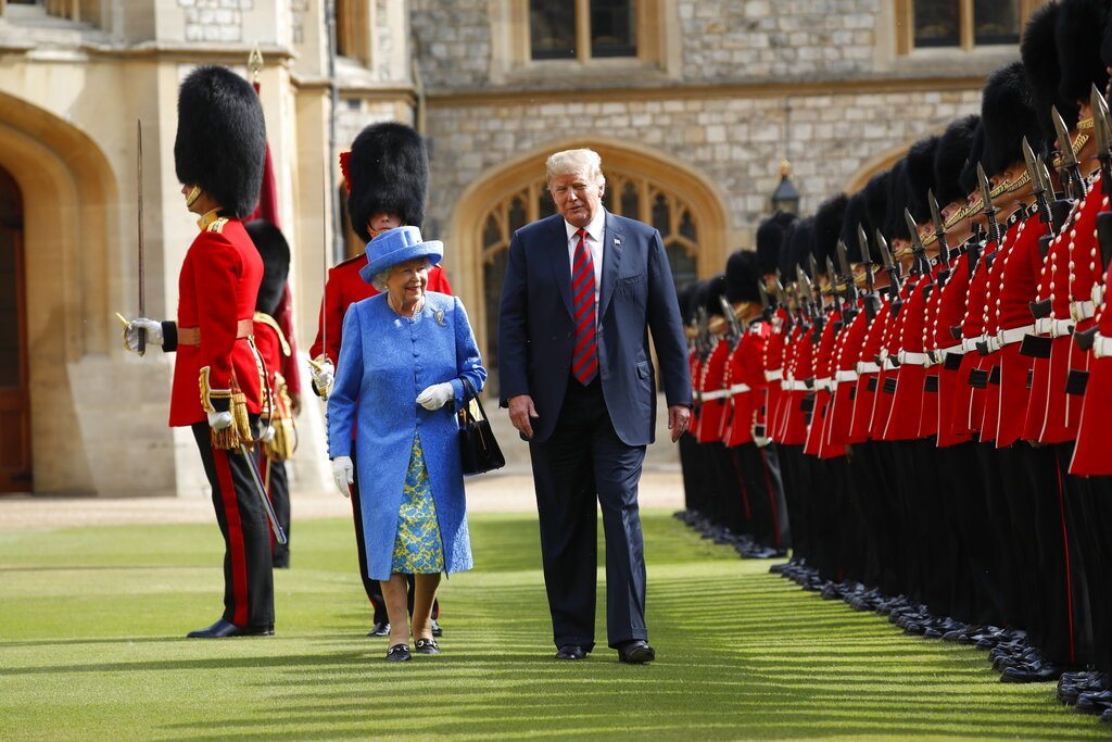In this Friday, July 13, 2018 file photo, U.S. President Donald Trump and Queen Elizabeth inspect the Guard of Honour at Windsor Castle in Windsor, England. (AP Photo/Pablo Martinez Monsivais, file)
