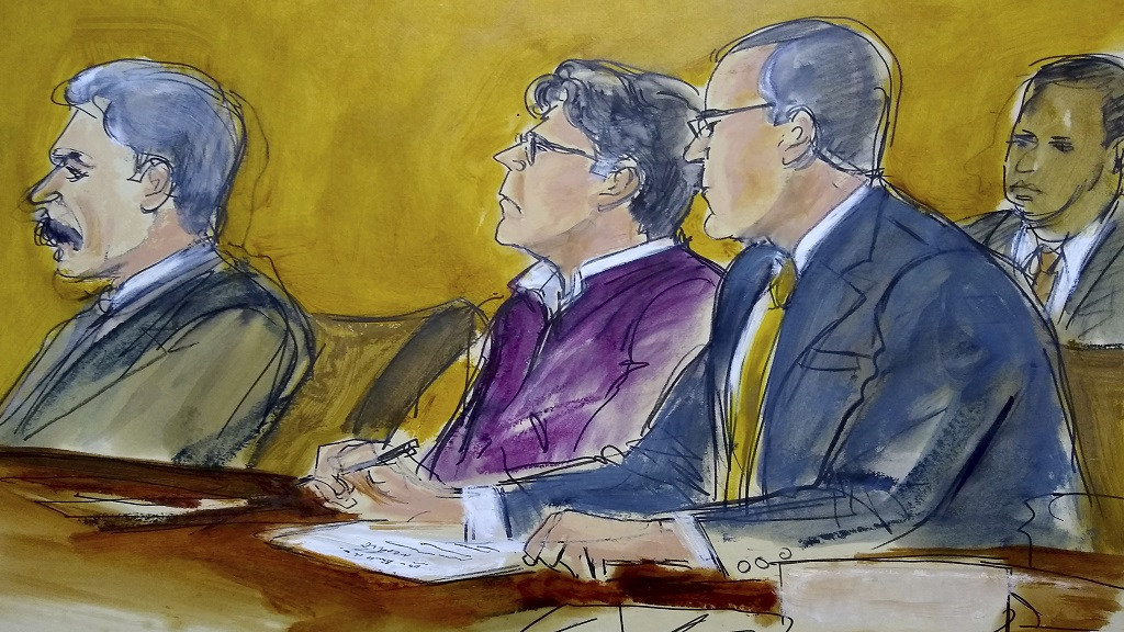 In this courtroom drawing, defendant Keith Raniere, center, sits at the defense table with his attorneys Paul DerOhannesian, left and Marc Agnifilo, as the jury foreperson reads the guilty verdict in his sex trafficking trial in New York, Wednesday, June 19, 2019. (Elizabeth Williams via AP)