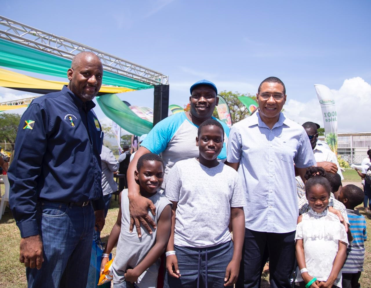 Prime Minister Andrew Holness (right), along with some fathers and their children, at a celebration of fatherhood at the Office of the Prime Minister (OPM) on Sunday afternoon. (Photos: Llewellyn Wynter)