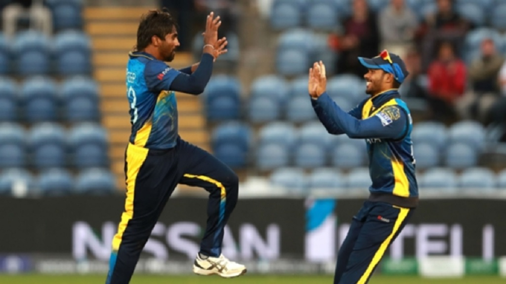 Nuwan Pradeep celebrates one of his four wickets against Afghanistan.