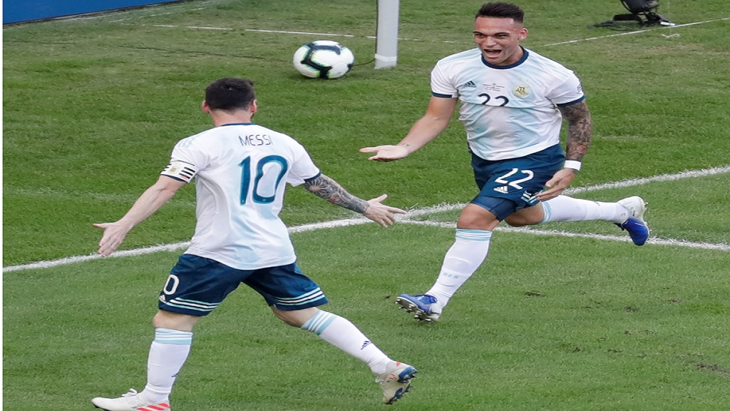Argentina's Lautaro Martinez, right, celebrates scoring his side's opening goal with teammate Lionel Messi during a Copa America quarterfinal football match against Venezuela at the Maracana stadium in Rio de Janeiro, Brazil, Friday, June 28, 2019