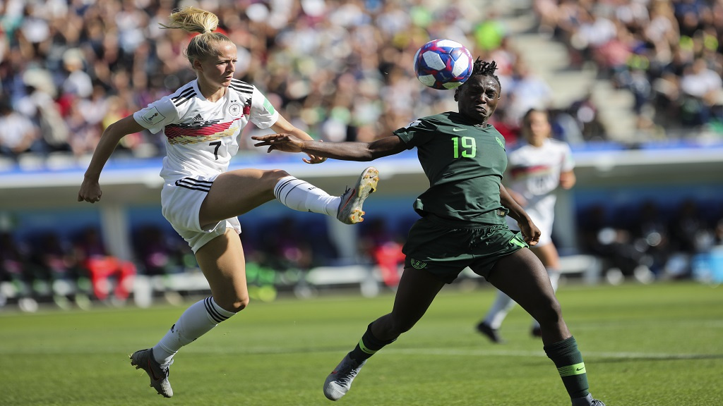 Germany's Lea Schueller, left, tussles for the ball with Nigeria's Chinwendu Ihezuo during the Women's World Cup round of 16 match  at the Stade del Alpes in Grenoble, France, Saturday, June 22, 2019.