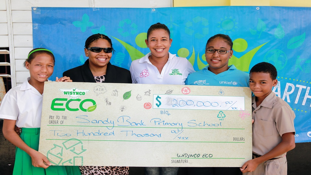 The team from Wisynco ECO poses along with student and teacher from Sandy Bank Primary, the first place winners of the third staging of ECO Club.