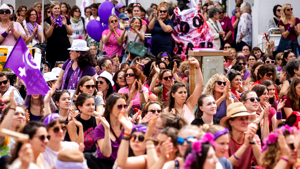 Women protest during a nationwide women's strike in Lucerne, Switzerland, June 14, 2019. There is list of several reasons motivating people to take part in the strike. These range from unequal wages to pressures on part-time employees, the burden of household work and sexual violence. (Alexandra Wey/Keystone via AP)