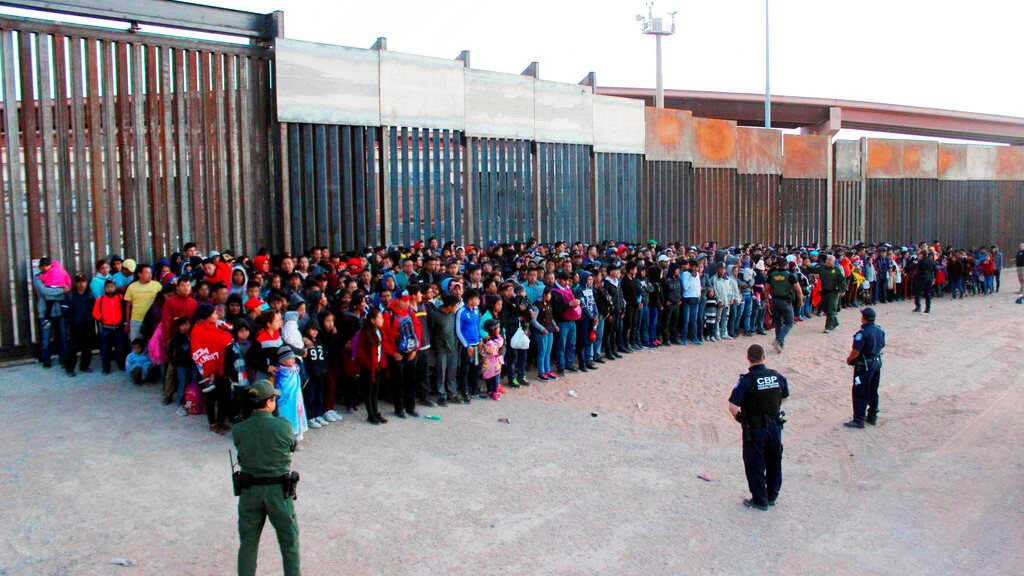 This May 29, 2019 file photo released by U.S. Customs and Border Protection (CBP) shows some of 1,036 migrants who crossed the U.S.-Mexico border in El Paso, Texas, the largest that the Border Patrol says it has ever encountered. (U.S. Customs and Border Protection via AP, File)
