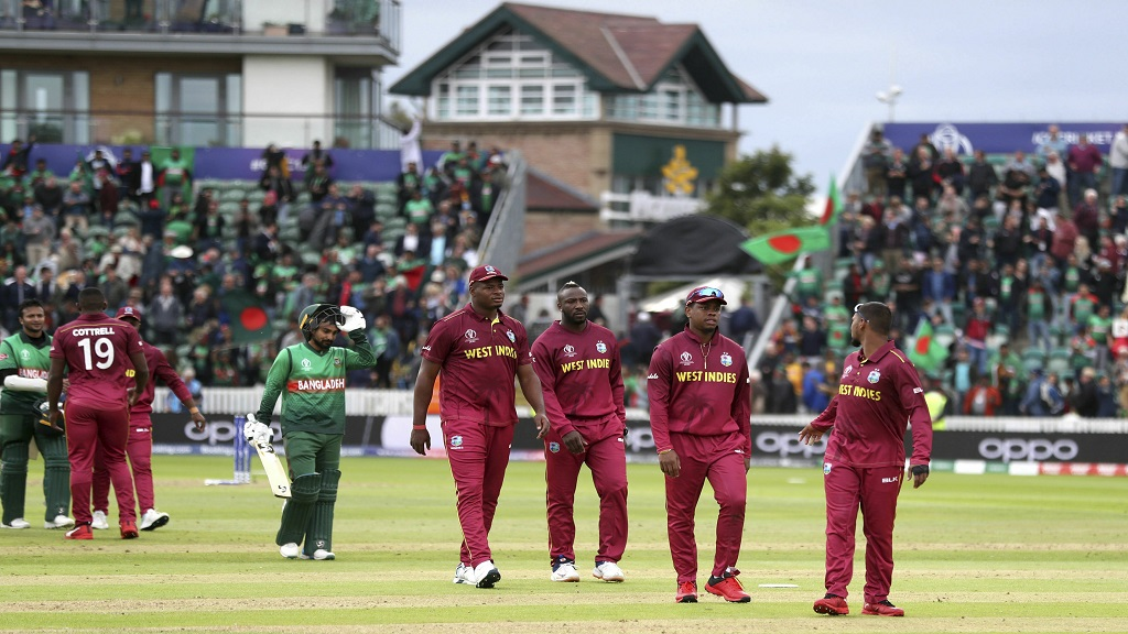 West Indies players walk off dejected after losing the Cricket World Cup match between West Indies and Bangladesh at The Taunton County Ground, Taunton, south west England, Monday June 17, 2019. (PHOTOS: David Davies/PA via AP)