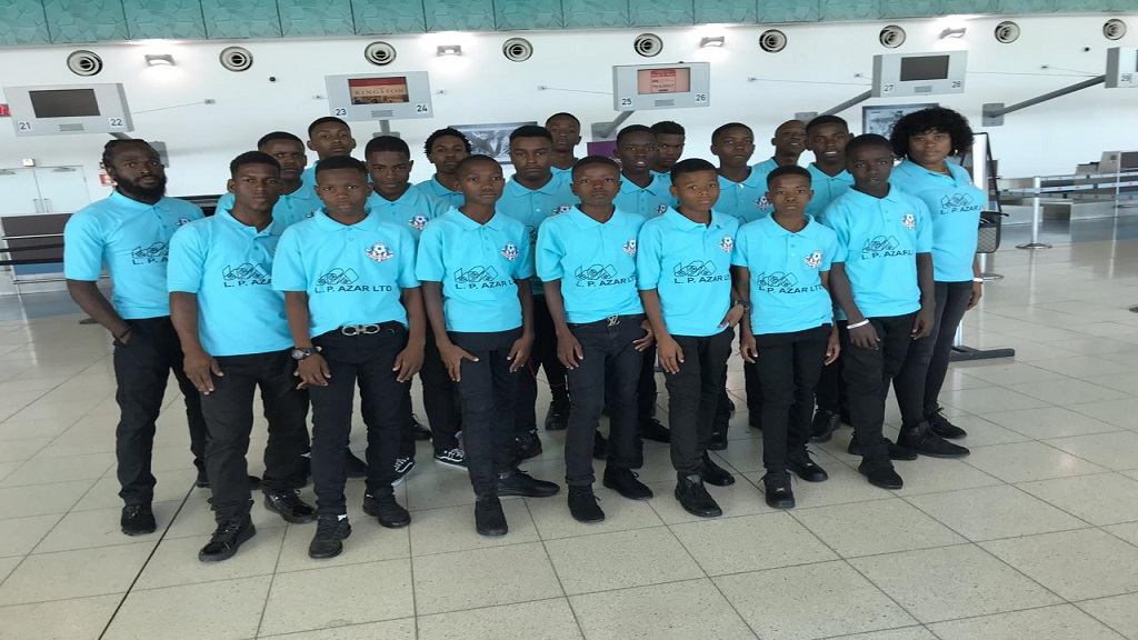 Portmore United FC's U15 team before departing the Norman Manley International Airport on Monday. (PHOTO: Contributed)