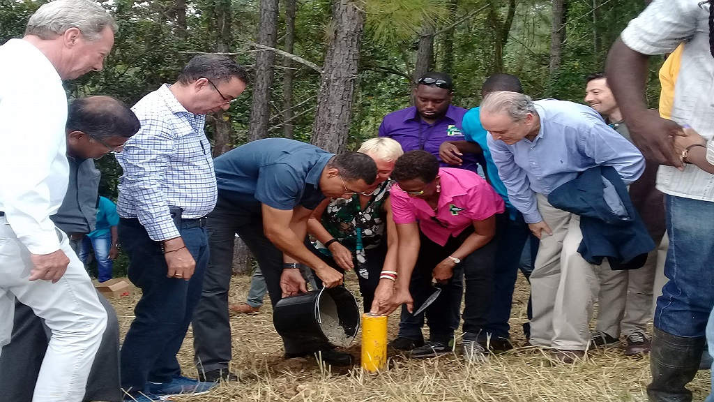 Prime Minister Andrew Holness (fourth left) places a permanent marker in the designated protected area of the Cockpit Country in Trelawny, on Wednesday. (PHOTOS: Contributed)