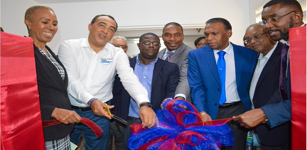 "Christopher Tufton (2nd left) Minister of Health and Wellness cuts the ribbon to officially open the interventional suite at the University Hospital of the West Indies (UHWI).  Joining him are (from left), Fayval Williams, Minister of Science, Energy and Technology; Everton Anderson, CEO, National Health Fund (NHF); Dr Carl Bruce, Medical Chief of Staff, UHWI; William ""Billy"" Heaven, CEO, Chase Fund; Professor Archibald McDonald, UWI and Kevin Allen, CEO UHWI."