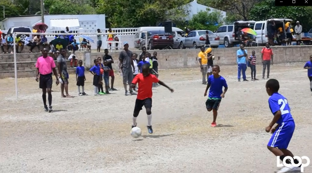 Children play football at a Joanna Webley-organised football tournament in Harbour View on Saturday. Joanna Webley is the daughter of the PNP caretaker candidate for the area, Joan Gordon-Webley