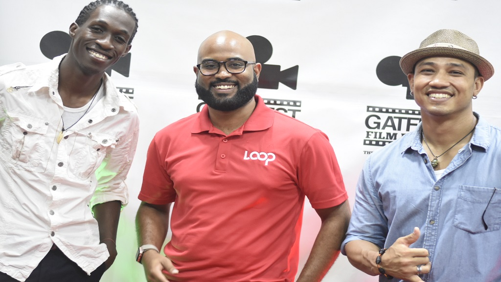 Trend Media senior marketing manager Andrew Brown (centre), with filmmakers Dario Shields (left) and Kyle Chin at the launch of Gatffest 2019. (PHOTO: Marlon Reid)